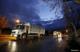 A Red Crescent aid convoy enters Madaya, Syria, Jan. 14, 2016.
