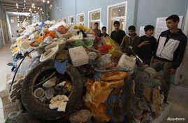 Jordanian students tour an exhibition on the amount of plastic waste in the Gulf of Aqaba and in the world's oceans in Amman, Nov. 19, 2014.