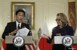 U.S. Secretary of State Hillary Clinton (R) and Japan's Foreign Minister Fumio Kishida hold a joint news conference after their meeting at the State Department in Washington, January 18, 2013.