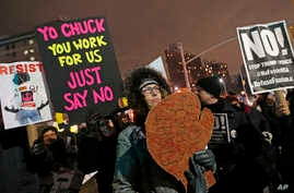 FILE - In this Jan. 31, 2017 file photo, demonstrators call out Senate Minority leader Chuck Schumer of N.Y. during a protest in his Brooklyn neighborhood in New York.