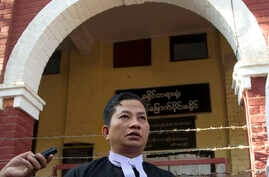 Than Zaw Aung, lawyer of two Reuters journalists Wa Lone and Kyaw Soe Oo, talks to journalists after their trial, Feb. 1, 2018, outside of Yangon, Myanmar.