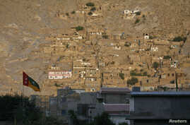 FILE - A view shows homes of the Hazara community on a hill in Mehrabad, Quetta.