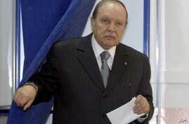 FILE - This May, 10, 2012, file photo shows Algerian President Abdelaziz Bouteflika exiting a parliamentary election voting booth in Algiers