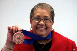 Beverly Hall, former Atlanta superintendent of public schools, holds up her award after she was named the 2009 Superintendent of the Year at the American Association of School Administrators' National Conference on Education in San Francisco, (File p