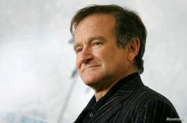 U.S. actor Robin Williams poses for photographers during a photo call