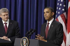 President Barack Obama and Canada's Prime Minister Stephen Harper take part in a joint news conference after their meeting at the White House in Washington, Friday, Feb. 4, 2011