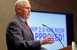 FILE - In this Jan. 27, 2015, file photo, then-Indiana Republican Gov. Mike Pence announces that the Centers for Medicaid and Medicare Services had approved the state's waiver request, called HIP 2.0, during a speech in Indianapolis.