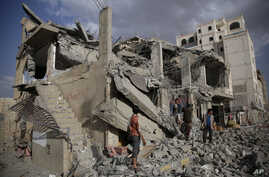Yemeni men inspect a house destroyed by a Saudi-led airstrike in Sanaa, Yemen, Monday, Jan. 25, 2016.