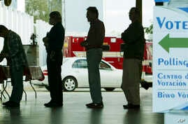 FILE -  Voters line up at a polling station to vote in Florida's presidential primary in Coral Gables, Florida.
