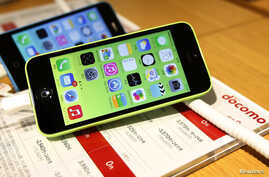 FILE - These then-new Apple iPhone 5c models were on display in at Tokyo store, Sept. 20, 2013. A 5c is at the center of Apple's battle with the FBI over efforts to break the company's proprietary auto-destruct security system.