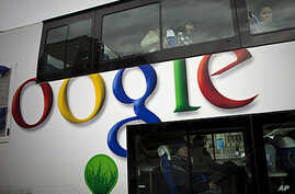 Passengers look through windows on a bus painted with an  advertisement Google in Beijing, China, (FILE PHOTO)