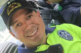 Slain Dallas police officer Patrick Zamarripa is pictured in this undated family handout photo.
