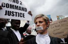 Zimbabwean lawyers carry placards as they march to demand justice for people detained in jail and others facing fast-track trials following recent protests in Harare, Zimbabwe, January 29, 2019.