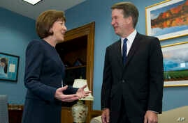 Sen. Susan Collins, R-Maine, speaks with Supreme Court nominee Judge Brett Kavanaugh at her office, before a private meeting on Capitol Hill in Washington on Aug. 21, 2018.