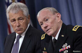 U.S. Secretary of Defense Chuck Hagel (L) and Joint Chiefs of Staff General Martin Dempsey hold a joint news conference at the Pentagon in Washington, March 17, 2013.