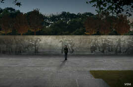 """A rendering of """"The Weight of Sacrifice"""" by Chicago architect Joseph Weishaar and New York sculptor Sabin Howard, the winning entry in an international contest to design a World War I memorial in Washington, D.C. (World War I Centennial Commission)"""