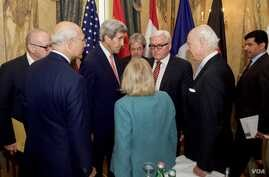 U.S. Secretary of State John Kerry chats with German Foreign Minister Frank-Walter Steinmeier, United Nations Special Envoy for Syria Staffan de Mistura, and Assistant Secretary of State for Near Eastern Affairs Anne Patterson on October 30, 2015, at