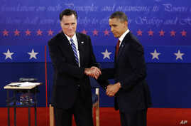 President Barack Obama and Republican presidential candidate and former Massachusetts Gov. Mitt Romney shake hands at the end of the second presidential debate at Hofstra University in Hempstead, N.Y., Tuesday, Oct. 16, 2012.
