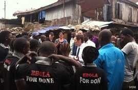 CDC Director Dr. Tom Frieden talks with Ebola survivors in Magazine Wharf, Sierra Leone. (Courtesy - U.S. Centers for Disease Control)