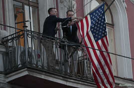 Employees take down the U.S. flag on the U.S. Consulate General in St. Petersburg, Russia March 31, 2018.