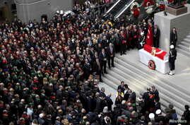 People attend the funeral ceremony of prosecutor Mehmet Selim Kiraz at the Justice Palace in Istanbul, Turkey, April 1, 2015.