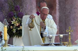 Pope Francis incenses the altar as he celebrates a Holy Mass in Brzegi, near Krakow, Poland, July 31, 2016.