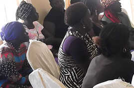 Members of the SPLM Women's League listen as a visiting delegation discusses plans to boost women's political clout