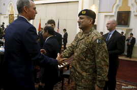 FILE - A member of U.S. delegation (L) shakes hand with a member of Pakistani delegation before a meeting in Kabul, Afghanistan, January 18, 2016.