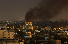 Smoke rises after an Israeli strike in Gaza City, July 11, 2014.