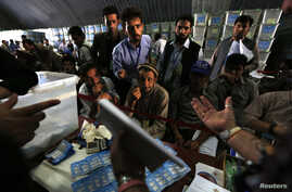Afghan election workers count ballot papers during an audit of the presidential run-off in Kabul August 3, 2014.