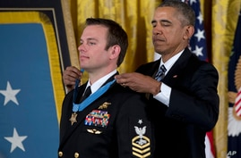 President Barack Obama presents the Medal of Honor to Senior Chief Special Warfare Operator Edward Byers during a ceremony in the East Room of the White House in Washington, Feb. 29, 2016.