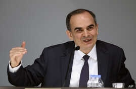 Turkey's Central Bank Governor Erdem Basci speaks during a press conference in Ankara, Turkey, Tuesday, Jan. 28, 2014.