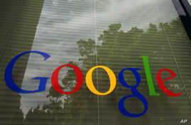 FILE - The Google logo on a window at the company's headquarters in Mountain View, Calif.