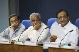 Indian Finance Minister P. Chidambaram, right, with Indian Coal Minister Shriprakash Jaiswal, center, and Coal Secretary S.K. Srivastava, in New Delhi, August 24, 2012.