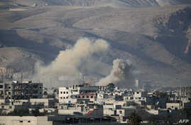 Smoke billows following Syrian government bombardments on the besieged rebel-held town of Hamouria in the eastern Ghouta region on the outskirts of the capital Damascus, March 3, 2018.