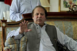 Former prime minister and leader of Pakistan Muslim League-N party, Nawaz Sharif, gestures while speaking to members of the media at his residence in Lahore, Pakistan, May 13, 2013.