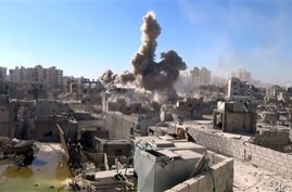 This image made from citizen journalist video posted by the Shaam News network, which is consistent with AP reporting, shows shelling in the Barzeh area of Damascus, Syria Tuesday, Sept. 17, 2013. Moscow insisted on Tuesday that a new Security Counci