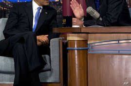 "President Barack Obama talks with David Letterman on the set of the ""Late Show With David Letterman"" in New York, Sept. 18, 2012."