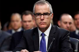 FILE - Acting FBI Director Andrew McCabe appears before a Senate Intelligence Committee hearing about the Foreign Intelligence Surveillance Act, on Capitol Hill in Washington, June 7, 2017.  McCabe has been buffeted by attacks from President Donald T...