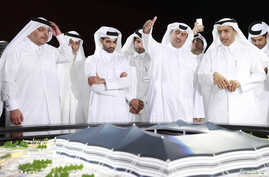 FILEL _ Secretary-General Hassan Al-Thawadi (3rd L) of Qatar's Supreme Committee for Delivery and Legacy, the nation's 2022 World Cup organizing committee, speaks during a news conferenc.