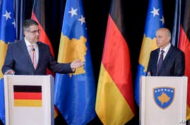 German Foreign Minister Sigmar Gabriel, left, gestures next to Kosovo's Prime Minister Isa Mustafa during a press conference in Kosovo's capital Pristina, April 13, 2017.