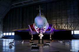 FILE - A Lockheed Martin F-35 Lightning II fighter jet is seen in its hangar at Patuxent River Naval Air Station, in the eastern U.S. state of Maryland, Oct. 28, 2015.