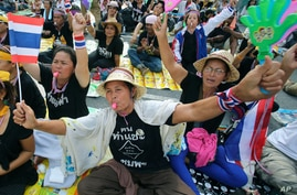 Anti-government protesters stage a sit-in at the Finance Ministry in Bangkok, Thailand, Nov. 26, 2013.