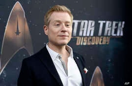 "FILE - Anthony Rapp, cast member in ""Star Trek: Discovery,"" poses at the premiere of the new television series in Los Angeles, Sept. 19, 2017."