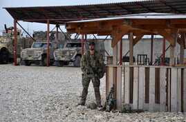 A soldier stands guard at Camp Shaheen in Mazar-i-Sharif, Afghanistan on March 26, 2017.