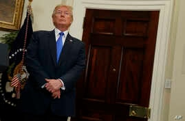President Donald Trump listens in the Roosevelt Room of the White House in Washington, Aug. 2, 2017, during an event to unveil legislation that would place new limits on legal immigration.