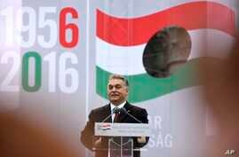 FILE - Hungarian Prime Minister Viktor Orban delivers a speech during the commemoration ceremony of the 1956 Hungarian revolution and freedom fight against communism and Soviet rule in downtown Budapest, Hungary, Oct. 23, 2016. Orban likes the immig