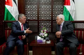 Palestinian President Mahmoud Abbas, right, meets with Jordan's King Abdullah II at his office in the West Bank city of Ramallah, Monday, Aug. 7, 2017.