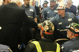 Robert Murray, founder and CEO of Murray Energy greets coal miners at the EPA hearing in Charleston, West Virginia, Nov. 28, 2017 before speaking to the panel supporting the repeal of the Clean Power Plan.
