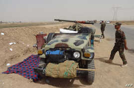 Kurdish Iraqi Peshmerga forces deploy their troops on the outskirts of the multi-ethnic city of Kirkuk, only 1 kilometer away from areas controlled by Sunni Muslim Jihadists from the Islamic State of Iraq and the Levant (ISIL) in northern Iraq, June